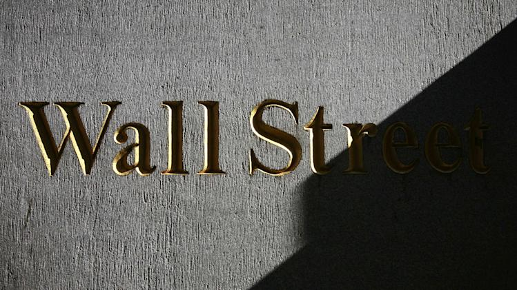 FILE - In this Monday, March 8, 2010, file photo, a sign for Wall Street is shown near the New York Stock Exchange. Global shares were mixed Wednesday Aug. 27, 2014 after the latest record close for the Standard & Poor's 500, with Europe off to a shaky start despite a strong day in Asia. (AP Photo/Mark Lennihan, File)