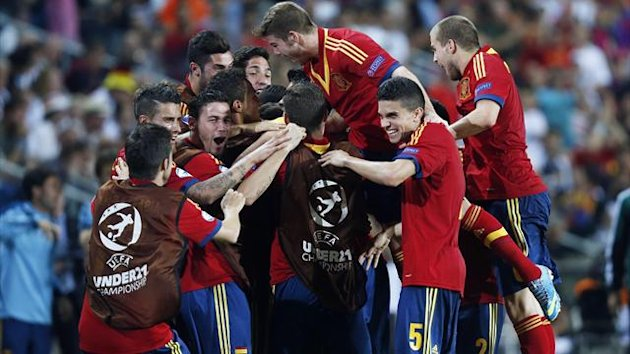 Spain's players celebrate their goal against Germany during their UEFA European Under-21 Championship match at Netanya Municipal Stadium in Netanya