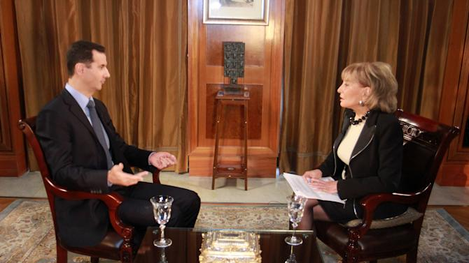 """In this undated image provided by ABC, Syrian President Bashar Al-Assad speaks with ABC News Anchor Barbara Walters for an interview airing Wednesday, Dec. 7, 2011, on ABC. Assad denied he ordered the deadly crackdown on a nearly 9-month-old uprising in his country, claiming he is not in charge of the troops behind the assault. Speaking to Walters in a rare interview that aired Wednesday, he maintained he did not give any commands """"to kill or be brutal."""" (AP Photo/ABC, Rob Wallace)"""