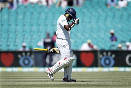 Sri Lanka's Herath walks from the field after being bowled by Australia's Bird during the fourth day's play of the third cricket test match at the Sydney Cricket Ground