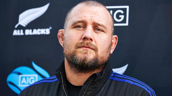 New Zealand's prop Tony Woodcock smiles during a 2015 Rugby World Cup promotional event in Canary Wharf, east London, on September 25, 2015
