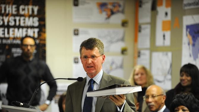 "Rip Rapson, President and CEO, The Kresge Foundation, holds  a book titled ""Detroit Future City""  presented  during a news conference. The foundation announced $150 million dollars in support of the framework for future decision making.  The announcement was made at the DWPLTP Homebase on Wednesday Jan. 9, 2013. (AP Photo/The Detroit News, Max Ortiz)"