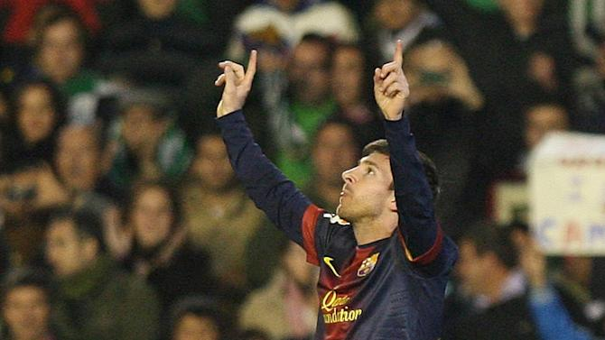 CAPTION CORRECTION, CORRECTS SPELLING OF PLAYER NAME - Barcelona's Lionel Messi from Argentina reacts after scoring against Betis during their La Liga soccer match at the Benito Villamarin stadium, in Seville, Spain, Sunday, Dec. 9, 2012. (AP Photo/Angel Fernandez)
