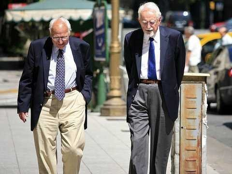 Old men walking down city street