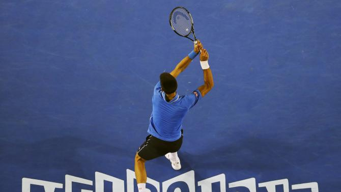 Djokovic of Serbia hits a return to Wawrinka of Switzerland during their men's singles semi-final match at the Australian Open 2015 tennis tournament in Melbourne