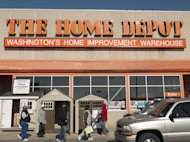 People walk outside a Home Depot store in Washington February 20, 2012. REUTERS/Jonathan Ernst