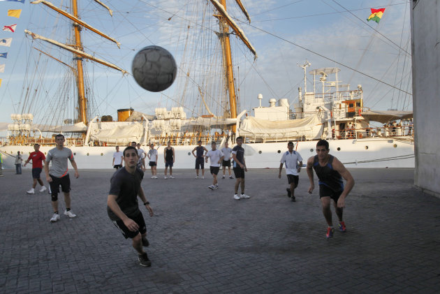 Crew members play soccer next to the three-masted ARA Libertad, a symbol of Argentina&#39;s navy, as it sits docked at the Tema port, outside Accra, Ghana, Saturday, Oct. 20, 2012. Argentina announced the immediate evacuation Saturday of about 300 crew members from the Libertad, a navy training ship seized in Africa nearly three weeks ago as collateral for unpaid bonds dating from the South American nation&#39;s economic crisis a decade ago.(AP Photo/Gabriela Barnuevo)