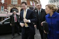 Britain&#39;s deputy Prime Minister Nick Clegg (2nd L) arrives to take part in a phone-in show at a radio station in central London February 27, 2013. REUTERS/Suzanne Plunkett