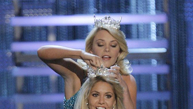 FILE - In this Jan. 26, 2008 file photo, Kirsten Haglund is crowned Miss America 2008 by former Miss America Lauren Nelson during the Miss America Pageant at the Planet Hollywood hotel and casino in Las Vegas.  (AP Photo/Jae C. Hong)
