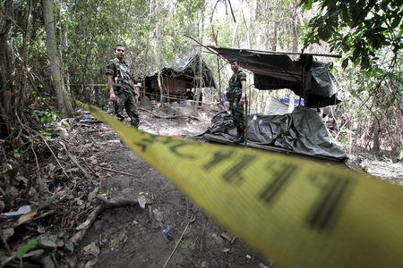 Bodies from Thai mass grave show no initial signs of violent death: police