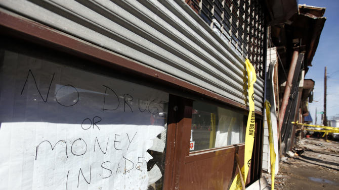 A sign proclaiming a lack of valuables inside is posted in the door of a veterinary clinic on a storm and fire ravaged block in Rockaway Beach, Tuesday, Nov. 6, 2012, in the the Queens borough of New York. Weather experts have some good news for beleaguered coastal residents in the Northeast: A new storm that threatened to complicate Hurricane Sandy cleanup efforts now looks like it will be weaker than expected.(AP Photo/Jason DeCrow)