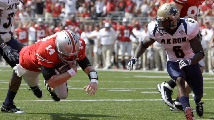 Ohio State quarterback Joe Bauserman (14) beats Akron cornerback Manley Waller to the end zone for a touchdown in the first quarter of an NCAA college football game in Columbus, Ohio on Saturday, Sept. 3, 2011.  (AP Photo/Jay LaPrete)