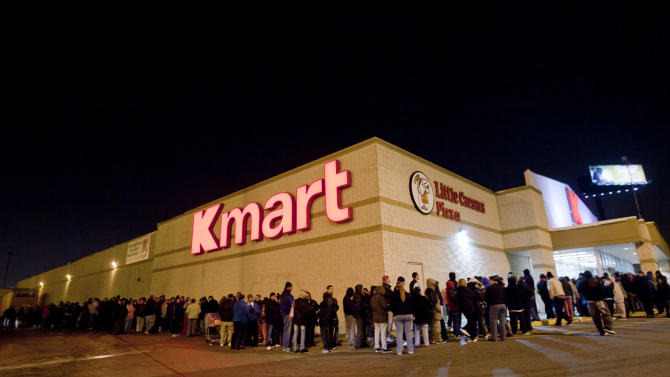 IMAGE DISTRIBUTED FOR KMART - Customers wait in line for doorbuster deals at the Kmart on Addison Street in Chicago on Thanksgiving Thursday, Nov. 22, 2012. Kmart was the first major retailer nationwide to kick off pre-Black Friday shopping on Thanksgiving morning at 6 a.m.  (John Konstantaras/AP Images for Kmart)