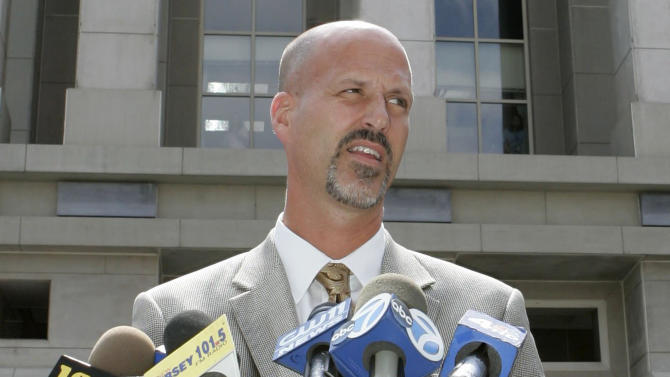 Michael Drewniak speaks to reporters outside the U.S. District courthouse in Newark
