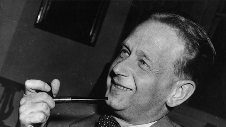 FILE - In this May 19, 1953 file photo, Dag Hammarskjold, recently appointed secretary general of the United Nations who is on a visit to Sweden, smokes his pipe at a press conference held at the Foreign Office in Stockholm. America's National Security Agency may hold crucial evidence about one of the greatest unsolved mysteries of the Cold War _ the cause of the 1961 plane crash which killed United Nations Secretary-General Dag Hammarskjold, a commission which reviewed the case said Monday, Sept. 9, 2013. Widely considered the U.N.'s most effective chief, Hammarskjold died as he was attempting to bring peace to the newly independent Congo. The crash of his DC-6 aircraft in the forest near Ndola Airport in modern-day Zambia has bred a rash of conspiracy theories, many centering on some startling inconsistencies. (AP Photo)