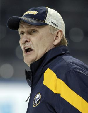 FILE - In this Jan. 11, 2012, file photo, Buffalo Sabres coach Lindy Ruff talks with players during NHL hockey practice in Buffalo, N.Y. Ruff was fired on Wednesday, Feb. 20, 2013, after the team's latest slow start to the season and amid growing criticism from the team's fan base. (AP Photo/David Duprey, File)