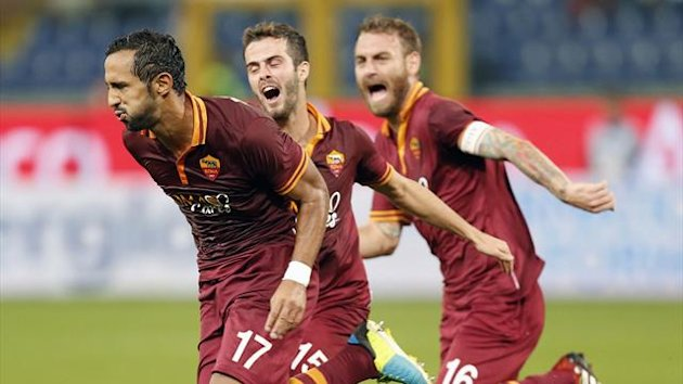 AS Roma Medhi Benatia (L) celebrates with his teammates Alessandro Florenzi (C) and Daniele De Rossi