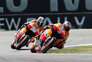 Australian Honda rider Casey Stoner (R) leads Spanish Honda rider Dani Pedrosa during the MotoGP race of the Dutch Grand Prix in Asssen. Stoner started on pole but soon found himself behind Pedrosa before retaking the lead with nine laps remaining and surging clear to win by a comfortable margin