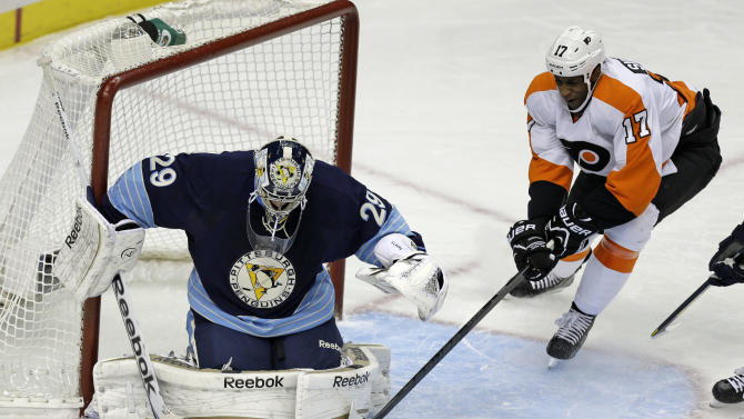 Pittsburgh Penguins goalie Marc-Andre Fleury (29) blocks a shot as Philadelphia Flyers right wing Wayne Simmonds (17) reaches for the rebound in the first period of an NHL hockey game in Pittsburgh, Sunday, March 24, 2013. (AP Photo/Gene J. Puskar)
