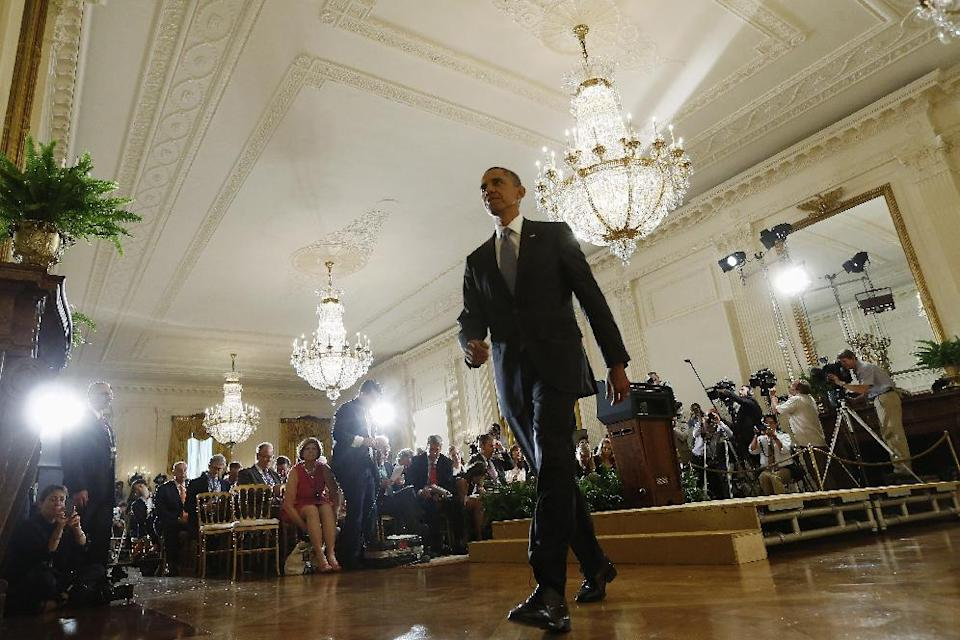 President Barack Obama leaves after his news conference in the East Room at the White House in Washington, Friday, Aug. 9, 2013. The president said he'll work with Congress to change the oversight of some of the National Security Agency's controversial surveillance programs and name a new panel of outside experts to review technologies. (AP Photo/Charles Dharapak)