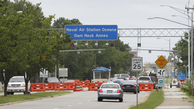 Cars pass through the main gate of the Naval Air Station Oceanna Dam Neck  Annex in Virginia Beach , Va., Saturday, Aug. 6, 2011.   The base is the headquarters for Seal Team Six whose team members were involved in a helicopter crash in Afghanistan.  (AP Photo/Steve Helber)