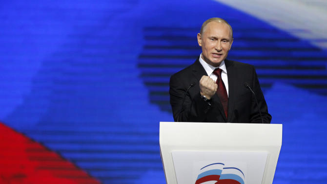 Prime Minister Vladimir Putin agestures as he speaks during a United Russia party congress  in Moscow,  Russia, Sunday, Nov. 27, 2011. Prime Minister Vladimir Putin has been formally nominated by the ruling United Russia party to run for president in next March's election. (AP Photo/Alexander Zemlianichenko)