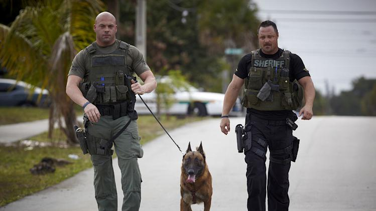 "Jerry Wenge and Geoff Brown with K-9 Bali as seen on ""Unleashed: K9 Broward County."""