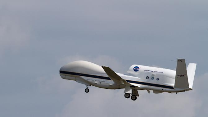 """CORRECTS DAY OF THE WEEK - NASA's Global Hawk 872 Takes off for HS3 Science Flight #5 on Tuesday Sept. 4, 2012 less than 5 hours after NASA 871 landed at NASA's Wallops Flight Facility, Wallops Island, Va. The flight of NASA 872 takeoff marks the first """"back-to-back"""" flights of two Global Hawks in the same day for HS3. NASA is using former military surveillance drones to help study how tropical storms intensify. The unmanned Global Hawk aircraft are taking off from NASA's Wallops Flight Facility on the Eastern Shore of Virginia, where they're studying storms that form over the Atlantic Ocean. NASA officials say while forecasting models predicting a storm's path have improved greatly over the past few decades, there hasn't been much progress producing models that predict a hurricane's strength. (AP Photo/NASA)"""