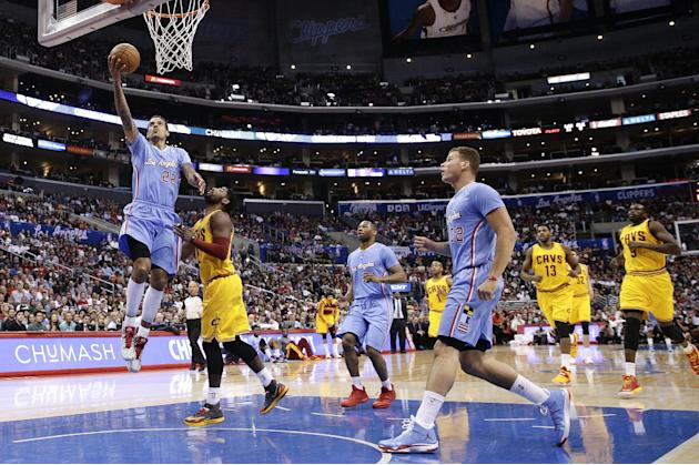 Los Angeles Clippers's Matt Barnes(22) drives for a layup during the first half of an NBA basketball game against the Cleveland Cavaliers on Sunday, March 16, 2014, in Los Angeles. (AP Photo/Jae C