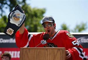 Blackhawks goalie Crawford addresses the crowd during a rally in Chicago