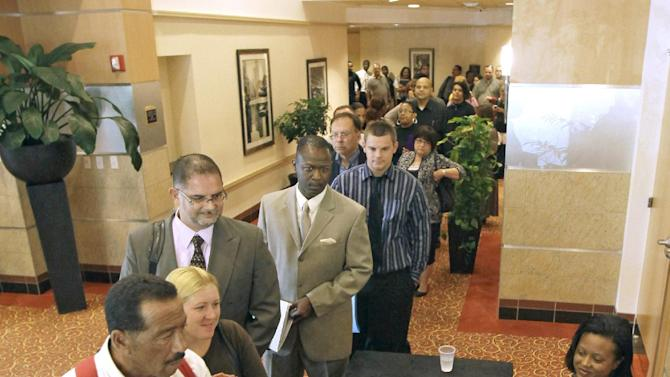 FILE - In this Sept. 13, 2011 file photo, applicants line up at the door to enter a job fair at the Crowne Plaza Hotel in Orlando, Fla. Applications for unemployment benefits fall to 390,000 Thursday, Nov. 10, 2011, lowest level since mid-April. (AP Photo/John Raoux, File)