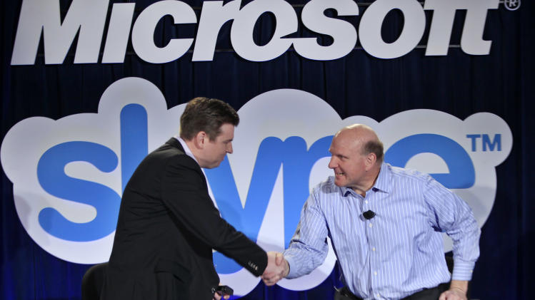 Microsoft CEO Steve Ballmer, right, and Skype CEO Tony Bates, left, shake hands during a news conference in San Francisco, Tuesday, May 10, 2011, to announce Microsoft's acquisition of Skype. (AP Photo/Paul Sakuma)