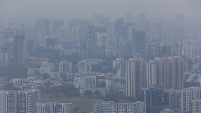 A general view of residential apartments in the city skyline shrouded by haze in Singapore
