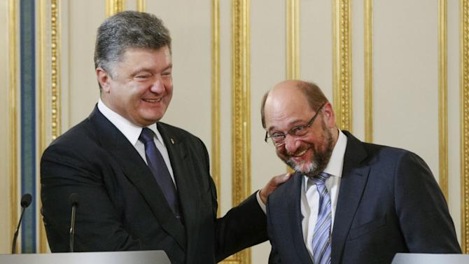 Ukraine's President Poroshenko shakes hands with President of the European Parliament Schulz as they meet with the media to make a statement in Kiev