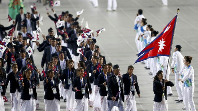 Flag bearer of Nepal Sneh Rajya Laxmi Rana leads the team into the Opening Ceremony of the 17th Asian Games in Incheon