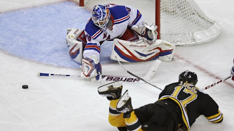 Boston Bruins left wing Milan Lucic (17) slides on his his belly as he makes a shot while New York Rangers goalie Henrik Lundqvist (30), of Sweden, makes a save during the third period in Game 5 of the Eastern Conference semifinals in the NHL hockey Stanley Cup playoffs in Boston, Saturday, May 25, 2013. (AP Photo/Charles Krupa)