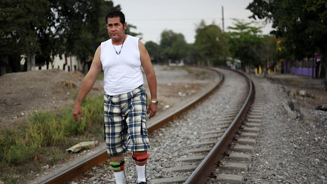 In this Wednesday March 6, 2013 photo, Jose Guadalupe Rodriguez-Saldana, 38, walks with orthopedic supports on the train tracks in the town of Tierra Blanca, Veracruz state, Mexico.  Rodriguez-Saldana and another friend suffered serious injuries during a car accident last May 2008 in northwestern Iowa. After their employers insurance coverage ran out, Rodriguez-Saldana, who was not a legal citizen, was placed on a private airplane and flown to Mexico still comatose and unable to discuss his care or voice his protest. Hospitals confronted with absorbing the cost of caring for uninsured seriously injured immigrants are quietly deporting them, often unconscious and unable to protest, back to their home countries. (AP Photo/Felix Marquez)
