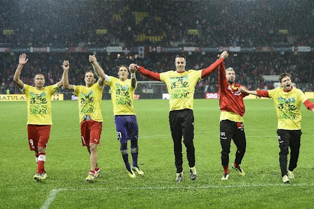 Switzerland's national soccer team, celebrates after winning the FIFA World Cup 2014 group E qualifying soccer match between Switzerland and Slovenia at the Stade de Suisse stadium in Bern, Switzerlan