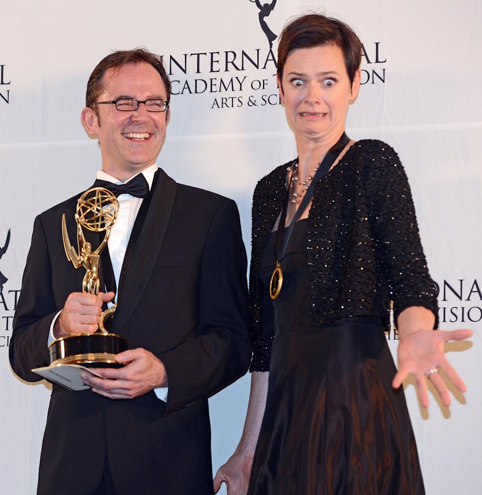 "Tristan Chytroschek, left, and Susanne Mertens of Germany pose with their statues after winning the Arts Programming award for ""Songs of War"" at the 40th International Emmy Awards,  Monday, Nov. 19, 2012 in New York. (AP Photo/Henny Ray Abrams)"