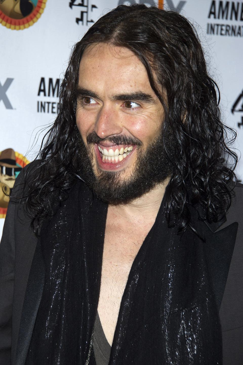 "Russell Brand arrives to Amnesty International's ""Secret Policeman's Ball"" in New York, Sunday, March 4, 2012. (AP Photo/Charles Sykes)"
