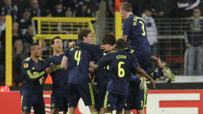 Ajax players react after Christian Eriksen scored against Belgium's RSC Anderlecht during their round of 32, first leg, of the Europa League soccer match, in Brussels, Thursday Feb. 17, 2011. (AP Photo/Yves Logghe)
