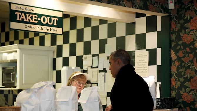 U.S. President Barack Obama places his order at the Feed Store, near the Old State Capitol in Springfield, Illinois