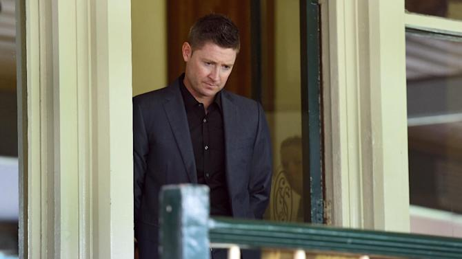 Australian cricket player Michael Clarke inspects a plaque remembering the late batsman Phillip Hughes before it is mounted in the Member's Stand at the Sydney Cricket Ground on January 5, 2015