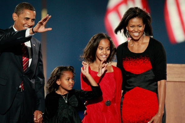 U.S. President elect Barack Obama walks on stage, with his wife Michelle (R) and daughters Malia (2nd R) and Sasha to, address his supports during an election night gathering in Grant Park on November