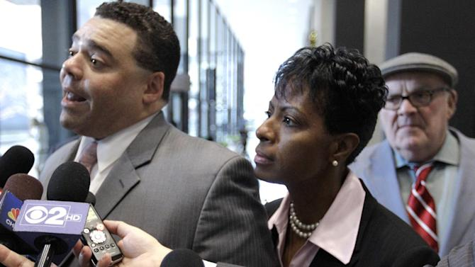 From left, Sam Adam Jr., Vivian Tarver-Varnado, and Sam Adam Sr., attorneys for Cook County Commissioner William Beavers arrive at the federal courthouse Monday, Dec. 3, 2012, in Chicago for jury selection on the first day of his federal tax evasion trial. The 77-year-old Democrat is accused of diverting tens of thousands of dollars from campaign accounts for personal use without reporting it as income on tax returns and of then attempting to cover up the deeds. (AP Photo/M. Spencer Green)