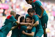 Mexico's forward Oribe Peralta (C) celebrates with teammates after he scored his team's second goal in the men's football final match between Brazil and Mexico at Wembley stadium in London during the London Olympic Games on August 11, 2012