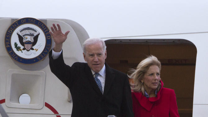 U.S. Vice President Joe Biden, left, accompanied by his wife Jill Biden, right, walks out of Air Force Two upon arrival at the Tegel airport in Berlin, Germany, Friday, Feb. 1, 2013. Biden is expected to meet with Chancellor Angela Merkel in Berlin and to attend the annual Munich Security Conference in Munich that starts later Friday. In his meeting with Merkel - his first official visit to Berlin since first taking office in 2009 - Biden is to address international issues, bilateral ties, efforts to seal a free trade deal between Europe and the U.S. and a possible visit by US President Barack Obama to Berlin.(AP Photo/Gero Breloer)