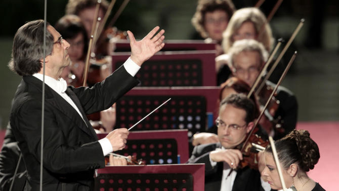 Riccardo Muti, left, conducts his orchestra during a concert offered by Italian President Giorgio Napolitano to celebrate Pope Benedict XVI's Pontificate at the Vatican, Friday, May 11, 2012. (AP Photo/Gregorio Borgia)