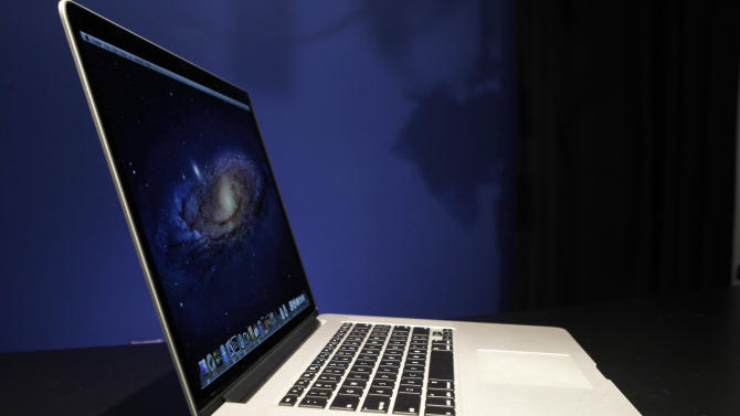 Apple cuts MacBook Pro price, updates processors