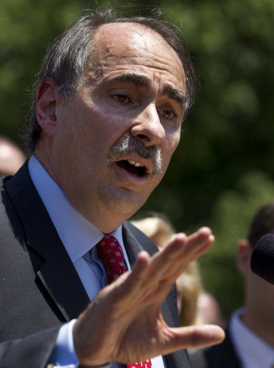 David Axelrod, a strategist for President Obama, addresses a crowd in front of the Statehouse, in Boston Thursday, May 31, 2012. Axelrod criticized former Mass. Gov. and Republican Presidential candid